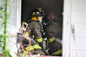 Kevin Spradlin | PeeDeePost.com Firefighters head into a burning home on Cartledge Creek Road.