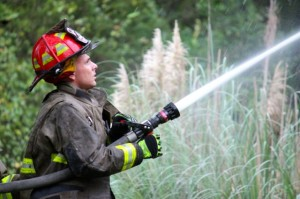 Kevin Spradlin | PeeDeePost.com A firefighter directs water into the living room area of a home in the 100 block of Cartledge Creek Road north of Rockingham late Sunday afternoon.