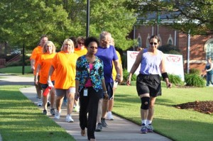 Kevin Spradlin | PeeDeePost.com Shareese Powell, public health educator with FirstHealth, leads a group of more than two dozen walkers around downtown Rockingham Wednesday evening.