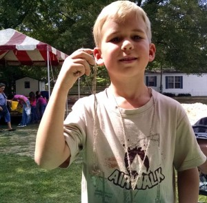 Photo by Jackie McAuley Shark teeth found in the Fossil Fair dig at the Rankin Museum in Ellerbe on Saturday were threaded into a necklace.