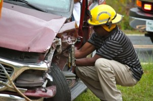 Kevin Spradlin | PeeDeePost.com Rescue personnel helped free the driver pinned in his Ford Expedition.