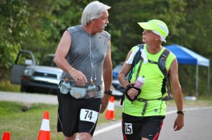 Kevin Spradlin | PeeDeePost.com John Porter, left, says the Hinson Lake 24-Hour Ultra Classic is about fellowship. He follows that approach in June at the Bethel Boogie Moonlight 50-miler near Ellerbe while running and talking with Donald Dees, of Aberdeen.
