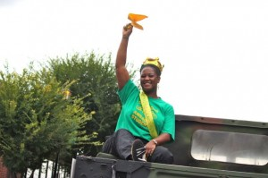 Kevin Spradlin | PeeDeePost.com Richmond Senior High School teacher Nikki Wells, who was voted early Friday as staff Spirit Award winner, rides in the back of a National Guard humvee and rallies the crowd.