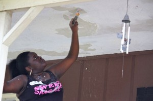 Kevin Spradlin | PeeDeePost.com Lakeyia Douglas, 18, helps the crew of volunteers with some work on her mother's Rockingham home.