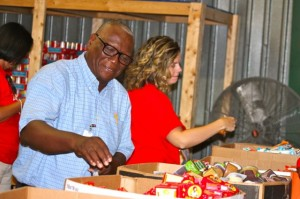 Kevin Spradlin | PeeDeePost.com Frank Liles, of Richmond County Schools, is at the vanguard of a dozen volunteers that helped prepare packaged foods for the Backpack Pals for Richmond County program.