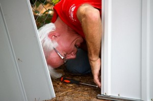 Kevin Spradlin | PeeDeePost.com Wayne Osborne, of Perdue, helps construct a storage shed at Sandhills Children's Center in Rockingham.
