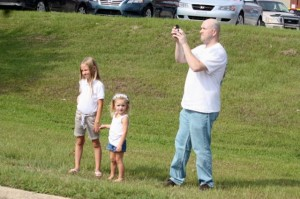 Kevin Spradlin | PeeDeePost.com Paul DeBerry and his daughters, Kaylee, 8, and Brystal, 3, turn into spectators along Highway Business 74 near Big Lots.