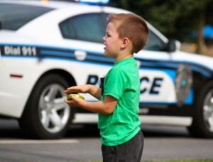Kevin Spradlin | PeeDeePost.com Bentley Cohoon, 3, cheers on the first-responders — especially his father, Joseph, of the Rockingham Fire Department.