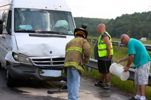 Kevin Spradlin | PeeDeePost.com Voluneers with Cordova Fire and Rescue help contain fluids from a commercial van involved in a two-vehicle collision Friday afternoon on Highway 74 west of Rockingham.