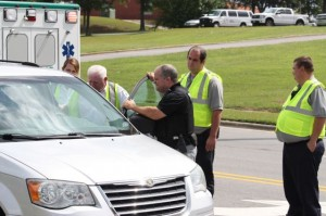 Kevin Spradlin | PeeDeePost.com FirstHealth EMS personnel check on the driver of a silver Chrysler Town & Country van Friday afternoon on Greene Street in Rockingham after it was involved in what appeared to be a fender-bender.