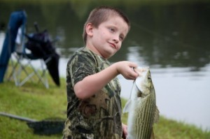 Kevin Spradlin | PeeDeePost.com Dalton Davis, 7, of Cassatt, is extremely proud of his first large hybrid bass.