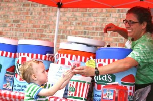 Kevin Spradlin | PeeDeePost.com Alex Hutchinson, of Rockingham, favors a particular flavor at the Rita's Ice stand.