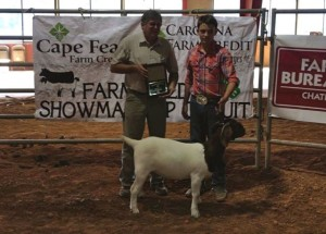 Submitted photo Coleman Berry won many of the top awards this past weekend at the Chatham County Livestock Show. He is shown here with judge, Ron Hughes.