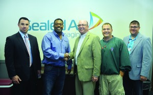 Richmond Community College recently partnered with Sealed Air to provide customized training for the company's workforce. Pictured, from left, are RCC Vice President for Workforce and Economic Development Robbie Taylor, Sealed Air Plant Manager Michael Hardy, RCC President Dr. Dale McInnis, Sealed Air Supervisor Doug McFayden and RCC Director of Customized Training Lee Eller.