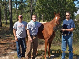 Submitted photo David Mattocks, Ben Patterson and Grayson McQueen stand with Bliss, missing since Sept. 20. He was found earlier today, Oct. 3.