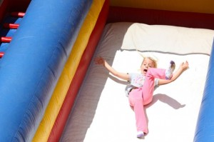 Kevin Spradlin | PeeDeePost.com Kaylee Dunn, 5, of Hamlet, lets loose on her way down the inflatable slide.