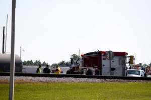 Kevin Spradlin | PeeDeePost.com Firefighters with the Hamlet Fire Department are permitted access to the scene of a train derailment at Yard A of the CSX facility along state Route 177 north of Hamlet.