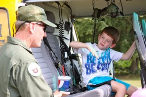 Kevin Spradlin | PeeDeePost.com Lucky Cipriani, 6, of Ellerbe, talks with pilot David Spooner about flight.
