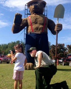 Kevin Spradlin | PeeDeePost.com Juliana Roberts, 5, of Albemarle, seeks a reassuring nod from her grandmother before visiting a larger-than-life Smokey the Bear on Saturday at Norman Fest.