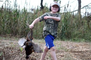 Kevin Spradlin | PeeDeePost.com Isaac Warner, 6, retrieves a pheasant brought down by his father during a Combat Warriors outing on Saturday in Ellerbe.