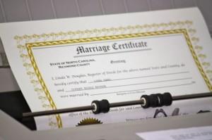 Kevin Spradlin | PeeDeePost.com Register of Deeds Linda Douglas prepares the marriage license for Linda and Tiffany Swinson.