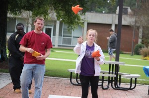 Kevin Spradlin | PeeDeePost.com Gary Boyette and Breanna Teal compete in an informal corn hole match Wednesday at RCC.
