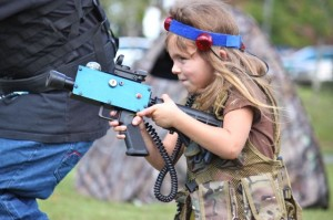 Kevin Spradlin | PeeDeePost.com Georgetta Bazen, 5, of Laurinburg, stays close to Leo Bazen in a game of Backyard Laser Tag.
