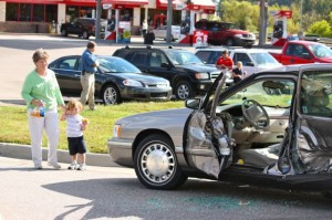 Kevin Spradlin | PeeDeePost.com The wife and great-grandson of the driver of a Cadillac sedan assess the damage to their vehicle.