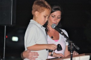 Kevin Spradlin | PeeDeePost.com Rebecca Phifer helps Evans Hodges read the opening prayer at the start of the third annual Footprints On Our Hearts memorial ceremony.