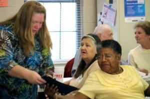 Kevin Spradlin | PeeDeePost.com Judy Tyndall presents Millie Wright, a volunteer at the Hamlet Senior Center, with a certificate of appreciation Saturday morning.