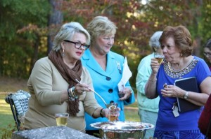 Kevin Spradlin | PeeDeePost.com Susanne McInnis, left, and Mary Bowles, second from left, enjoy Revolutionary War Punch McInnis prepared for the group.