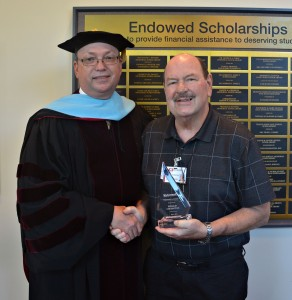 Dr. Dale McInnis, RCC president, stands with President's Award winner Phillip Covington, a College and Career Readiness instructor.