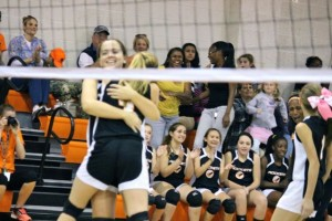 Kevin Spradlin | PeeDeePost.com Savannah Chappell, left, embraces Savannah Lampley after the winning point was awarded in the Rockets' sweep of the visiting Red Rams.