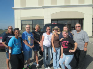 Submitted photo Big Rock Sports employees are joined by Backpack Pals founder Pastor Steve Crews.