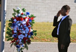Kevin Spradlin | PeeDeePost.com Vivian Little, U.S. Army (retired), renders a salute in the wreath-laying ceremony at the foot of the flagpole.