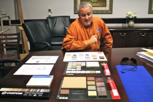 Kevin Spradlin | PeeDeePost.com Rockingham City Manager Monty Crump reviews the earth tone colors intended for use in the assembly hall and Pattan's Downtown Grille.