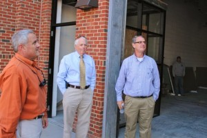 Kevin Spradlin | PeeDeePost.com Rockingham Mayor Steve Morris, center, talks with Tim Pattan, owner of Pattan's Downtown Grille, right, and City Manager Monty Crump outside Hitchcock Place.