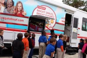 Kevin Spradlin | PeeDeePost.com Students line up outside the Colgate mobile dental clinic Thursday at Monroe Avenue Elementary School.