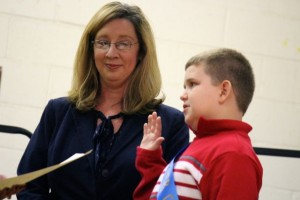 Kevin Spradlin | PeeDeePost.com Joshua Foster raises his right hand to be sworn in by Vickie Daniel (not pictured). Foster is standing beside Stacey Fain, school counselor.