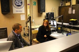 Photo by Caleb Neeley | WRSH 91.1 FM MaKayla Bacon, right, talks with Kevin Spradlin of The Pee Dee Post on Friday at the weekly 11:30 a.m. broadcast. Bacon spoke about how important  music has been to turning around her academic career. She's used the trumpet as a catalyst not only to become an honor student; music also has inspired a career. Caleb Neeley and Tony Hogan served as station engineers during the five-minute segment.