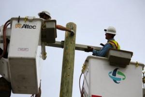Kevin Spradlin | PeeDeePost.com Duke Energy work crew installs a new telephone pole