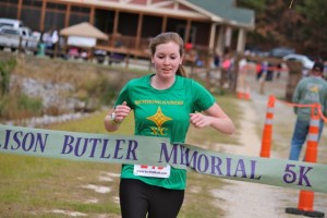 Kevin Spradlin | PeeDeePost.com Cameron Hudson crosses the finish line on Saturday as top female in the second annual Allison Butler Memorial 5K at Hinson Lake.