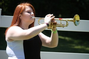 Kevin Spradlin | PeeDeePost.com MaKayla Bacon has used her trumpet to play Taps at several military-related ceremonies. She plays in honor of her grandfather, Laurence H. Oliver Sr., a retired Navy man.