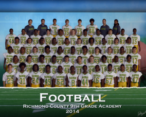 Submitted photo The 2014 Ninth Grade Academy Raiders capped a perfect 9-0 season with a 41-14 win over rival Scotland.  Top row, left to right: David McGuire, coach; Matt Poston, coach; James Jasper, Chase Coulthard, Gordon Pihl, Darius Andrade, Jay Jones, coach, Deion Green, coach. Fifth row: Steven Blyther, Chris Womack, Julius Saunders, Jerren Stuart, Clint Snipes, Daren Mason, Xavier Gibson, Dalton Jones, Andre Ellerbe, Malik Flowers. Fourth row: Devin McNair, Tyler Leviner, Adrridous Tillman, Samad Anderson, Brandon Jackson, Dalton Nuttall, Savion Streeter, Dante Miller, Hunter Cook, Dakota Wilson Third row: Feahntrai Bush, Jaydyn McNeil, Austin Watson, Shahim Sinclair, Cortez Sturdivant, Kaleb Douglas, Jeremy Wall, Curtis Freeman, Wesley Chavis, Jaleen Baldwin, Shane Summey. Second row: Jamel Baldwin, Garrett Williams, Antonio McRae, Khaliq Anderson, Austin Cook, Braydon Hoffman, Zane Ritter, Antuan Zeigler, Jordan Bennett, Jaquan Everett First row: Josh Bell, Bernard Gibson, Tre Cook, Jeremiah Dockery, Brandon Harris, Tommy Shelton, Dejuan Graham, Stefon Butler, K.J. Hill, Marquise Simmons.