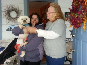 Submitted photo Pat Webb, right delivers Zaniel, the last pup from Lone Star Shih Tzu & Lhasa Apso Rescue in Houston,  to his happy mom and furever home earlier this month in Albany, N.Y.