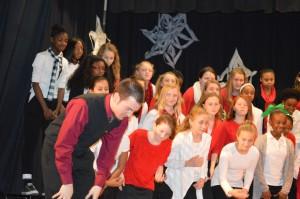 Photo by Judith Hamilton John Tyson takes a bow with the Rockingham Middle School choir.