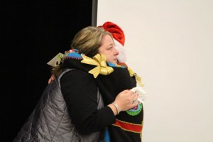 Kevin Spradlin | PeeDeePost.com Dr. Wendy Jordan, left, receives a hug while on stage after the Ugly Christmas Sweater Contest.