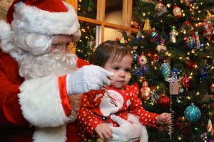 "Kevin Spradlin | PeeDeePost.com Elizabeth Payne, who will turn 1 on New Year's Day, visits with Santa. It might have been more like ""tolerate,"" and the candy cane helped smooth things over."