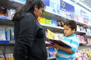 Kevin Spradlin | PeeDeePost.com Robert Wilson V, 5, of Cordova, shows his mother, Elvira Lopez, a book he might want to purchase as part of a Christmas gift from Dannell and Shervella Ellerbe.