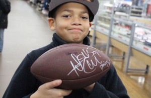 Kevin Spradlin | PeeDeePost.com It seems like this young man is proud of his Dannell Ellerbe autograph.